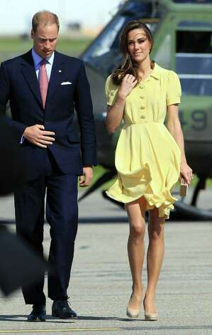 Eschewing her usual palette of neutrals, the duchess chose this sunny yellow Jenny Packham dress as she traveled to Calgary, Alberta, Canada.  Photo: Chris Jackson, Getty Images / 2011 Getty Images