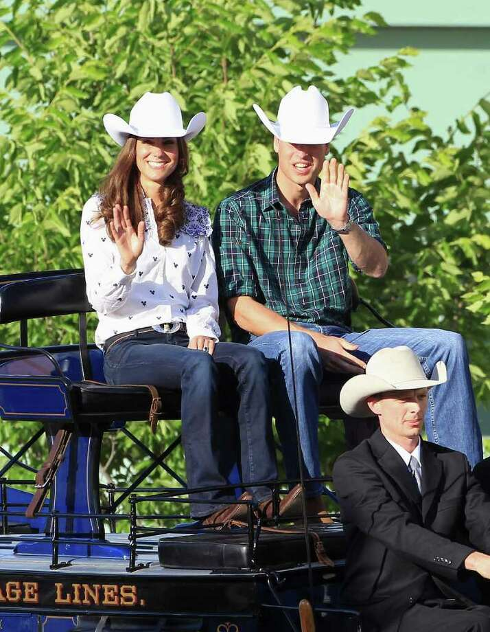 Kate went cowboy chic in this Western inspired blouse, jeans, and cowboy boots. The white cowboy hats were a traditional gift presented to the Duke and Duchess upon their arrival in Calgary -- a far cry from the ornamented fascinators Kate often wears in England! Photo: Chris Jackson, Getty Images / 2011 Getty Images