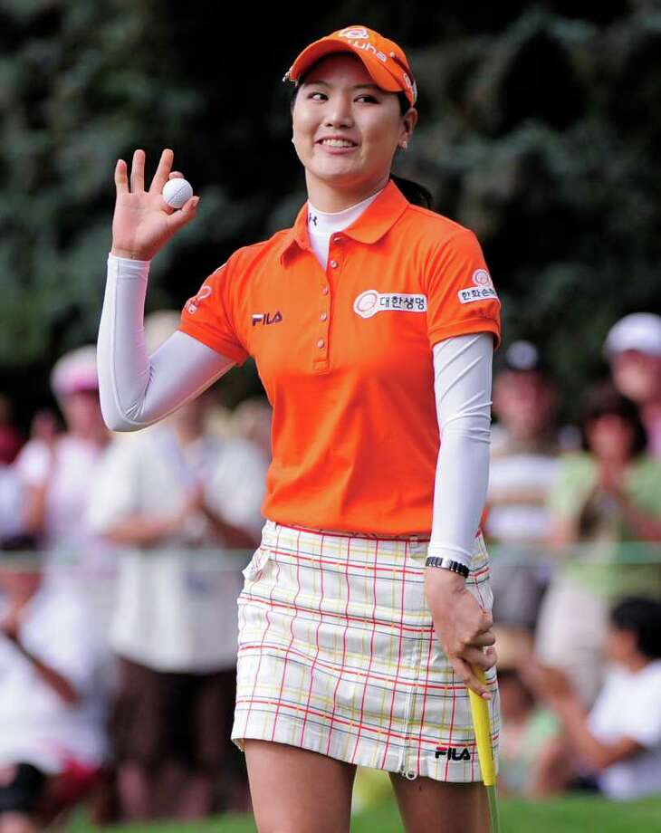 So Yeon Ryu of South Korea waves after sinking a birdie putt on the 18th hole to force a playoff during the delayed final round of the Women's U.S. Open golf tournament at the Broadmoor Golf Club on Monday, July 11, 2011, in Colorado Springs, Colo. (AP Photo/Mark J. Terrill) Photo: Mark J. Terrill, STF / AP