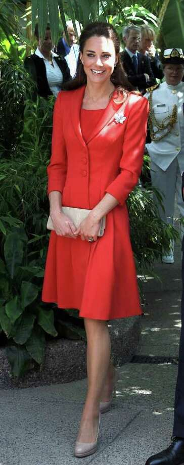 On her last day in Canada, the Duchess visited the Calgary Zoo, donning a patriotic red suit and her favorite maple leaf brooch.  Photo: Chris Jackson, Getty Images / 2011 Getty Images