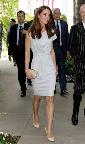 Landing in Los Angeles, Kate took on California in an airy gray dress and nude pumps.  Photo: Todd Williamson, Getty Images / 2011 Getty Images