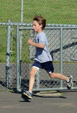 Ian Weiler, 11, of Westport, races to the finish line during the first race in the Westport Road Runners Summer Series on Saturday, July 2, 2011. Photo: Amy Mortensen
