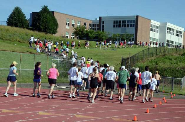 Runners compete during the first race in the Westport Road Runners Summer Series on Saturday, July 2, 2011. Photo: Amy Mortensen