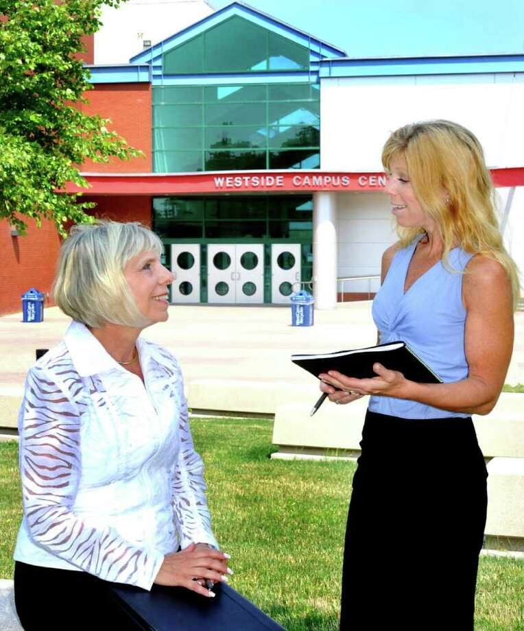 "Arlene Kreinik, left, a retired professor from the management department at Western Connecticut State University in Danbury chats with JoAnn Cueva, a program specialist with the Greater Danbury Chamber of Commerce. They are discussing the ""Leadership for Women Series"" where Kreinik will give the first lecture in the series. Photographed Monday, July 11, 2011. Photo: Michael Duffy / The News-Times"