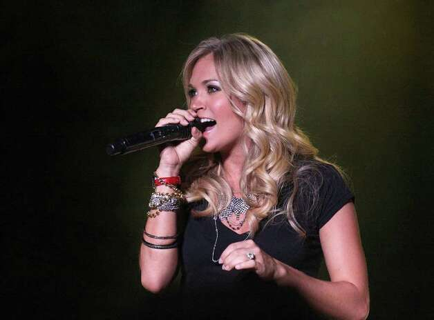 Country music entertainer Carrie Underwood performs during the 31st Country Concert Friday, July 8, 2011, in Fort Loramie, Ohio. Photo: AP