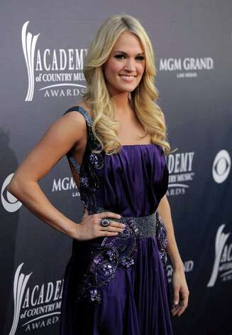 FILE - In this April 3, 2011 file photo, singer Carrie Underwood arrives at the 46th Annual Academy of Country Music Awards in Las Vegas, Nev. Underwood met with participants in the ACM Lifting Lives Music Camp on Wednesday, June 29, where she talked about her recording experiences, gave advice and posed for pictures. Photo: AP