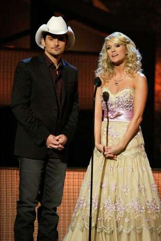 FILE - In this Nov. 11, 2009 file photo, country singers Brad Paisley, left, and Carrie Underwood host the 43rd Annual Country Music Awards in Nashville, Tenn.  Paisley and Underwood are hosting the 45th annual CMA Awards live from the Bridgestone Arena in Nashville, Tenn., on Wednesday, Nov. 9. It is the fourth time the couple has hosted together. Photo: AP