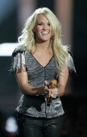 Carrie Underwood performs at the 2010 CMT Awards in Nashville, Tenn. Wednesday, June 9, 2010. Photo: AP