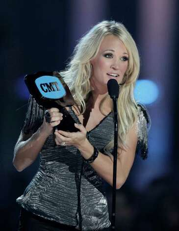 "Carrie Underwood accepts the ""Video of the Year"" award at the 2010 CMT Awards in Nashville, Tenn. Wednesday, June 9, 2010. Photo: AP"