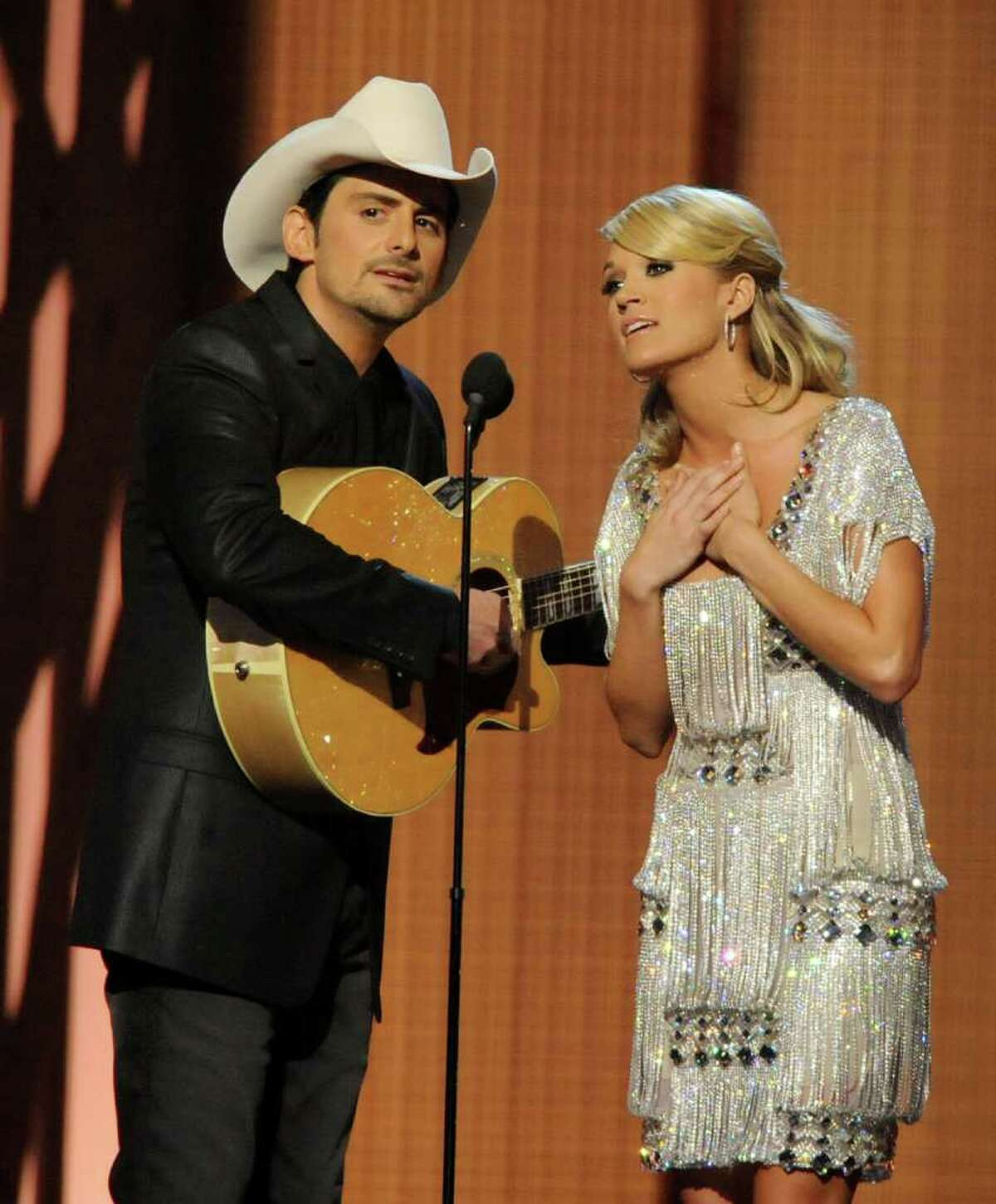 Carrie and Brad to host CMA Awards a 4th timeNASHVILLE, Tenn. (AP) -- Carrie Underwood and Brad Paisley will be back together again in November.They've been picked to host the Country Music Association Awards for a fourth straight year. The 45th annual awards will be aired live Nov. 9 from Nashville's Bridgestone Arena on ABC.Paisley is the reigning CMA entertainer of the year. Paisley and Underwood have won 19 CMA awards between them.As Paisley notes in a news release announcing their return, they've achieved a comic chemistry over the years with Underwood's class balancing