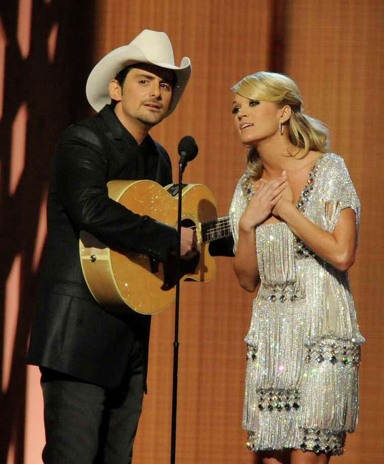 "Carrie and Brad to host CMA Awards a 4th timeNASHVILLE, Tenn. (AP) -- Carrie Underwood and Brad Paisley will be back together again in November.They've been picked to host the Country Music Association Awards for a fourth straight year. The 45th annual awards will be aired live Nov. 9 from Nashville's Bridgestone Arena on ABC.Paisley is the reigning CMA entertainer of the year. Paisley and Underwood have won 19 CMA awards between them.As Paisley notes in a news release announcing their return, they've achieved a comic chemistry over the years with Underwood's class balancing ""my non-class act. I'll try my best to not mess it up.""The CMA Awards are the most-watched country awards show. More than 16 million viewers tuned in last year.[Brad Paisley and Carrie Underwood perform at the CMAs in Nashville on Nov. 11, 2009] Photo: Rick Diamond, Getty Images / 2009 Getty Images"