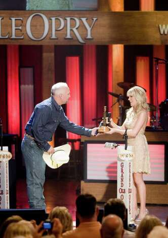 In this photo provided by the Grand Ole Opry, Carrie Underwood inducted as the newest member of the Grand Ole Opry by fellow Opry member Garth Brooks on Saturday, May 10, 2008 in Nashville.  (AP Photo/Grand Ole Opry, Chris Hollo)  ** NO SALES ** Photo: Chris Hollo, AP / Grand Ole Opry