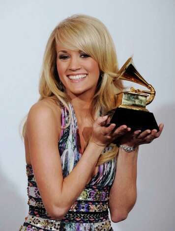 Carrie Underwood poses with the award for best female country vocal performance for 