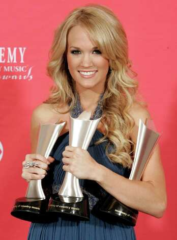Carrie Underwood holds the awards for top female vocalist, video of the year and album of the year for Some Hearts, at the 42nd Annual Academy of Country Music Awards on Tuesday, May 15, 2007, in Las Vegas. Photo: Eric Jamison, AP / AP