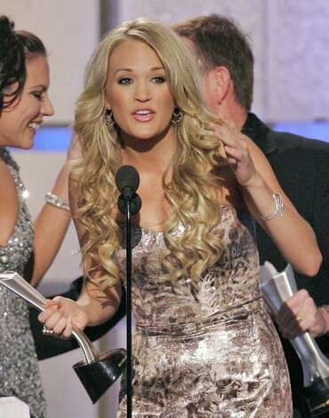Carrie Underwood accepts the award for album of the year for Some Hearts during the 42nd Annual Academy of Country Music Awards on Tuesday, May 15, 2007, in Las Vegas. Photo: Mark J. Terrill, AP / AP