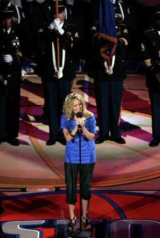 Recent American Idol winner Carrie Underwood sings the National Anthem prior to the start of during game four of the NBA Finals at The Palace of Auburn Hills near Detroit, Michigan on Tuesday, June 14, 2005. (Kin Man Hui/staff) Photo: KIN MAN HUI, SAN ANTONIO EXPRESS-NEWS / SAN ANTONIO EXPRESS-NEWS