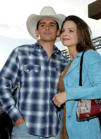 "**FILE**Country music recording artist Brad Paisley and actress Kimberly Williams arrive at the premiere of ""Open Range,"" in this file photo Aug. 11, 2003, in the Hollywood section of Los Angeles. The couple are the parents of a baby boy. The couple's first child was born at 5 a.m. CST Thursday Feb. 22, 2007 in a Nashville-area hospital, according to a statement from the country star's publicist. Photo: CHRIS WEEKS, AP / AP"
