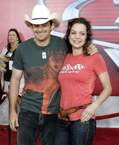 "**FILE**Country singer Brad Paisley and his wife Kimberly Williams attend the premiere of the animated film ""Cars"" at Lowe's Motor Speedway in Concord, N.C., on  May 26, 2006. They are expecting their first child together  in February, their spokeswoman, Michelle Bega, confirmed to The Associated Press on Wednesday, Sept. 20, 2006. Photo: CHUCK BURTON, AP / AP"