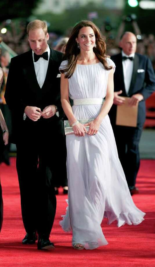 "The Duchess of Cambridge stole the show, outshining Hollywood's A-List on the red carpet at the BAFTA ""Brits to Watch"" event in Los Angeles, California. Her flowing lilac gown was designed by perennial favorite Alexander McQueen, and the Duchess finished the look with silver Jimmy Choo platforms and a pair of diamond earrings on loan from the Queen.  Photo: Pool, Getty Images / 2011 Getty Images"