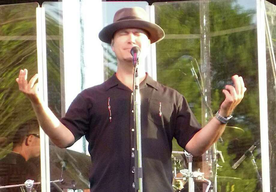 Scotty Morris, the lead singer for Big Bad VooDoo Daddy, belts one out during the Sunday concert at the Levitt Pavilion. Photo: Contributed Photo / Westport News contributed
