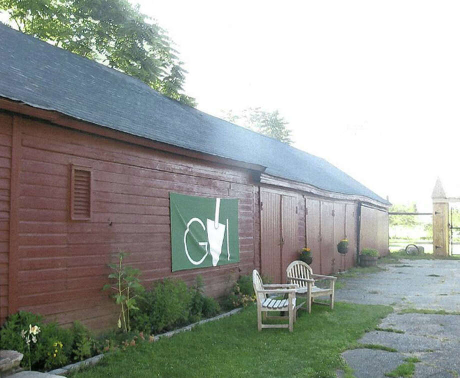 Pictured is the barn at the Wakeman Town Farm, a designated local historic property. Green Village Initiative, which leases the land from the town, is hoping to site the upper portion of a windmill on top of the south end of the barn roof (in the foreground of this photo). The power from the windmill be used to charge power tools at the farm, as it will be connected to a battery storage system. Photo: Contributed Photo / Westport News