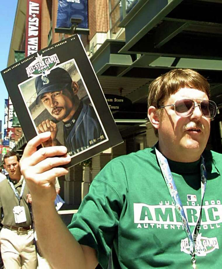 SEATTLE, UNITED STATES:  Program vendor Gary Sandwick holds a copy of the 2001 All-Star Game program bearing the likeness of  Seattle Mariners' Ichiro Suzuki of Japan outside Safeco Field 09 July 2001 in Seattle, Washington. Suzuki received 3.3 million votes to become the top vote getter in this years voting.   AFP PHOTO/Dan LEVINE Photo: DAN LEVINE, AFP/Getty Images / AFP