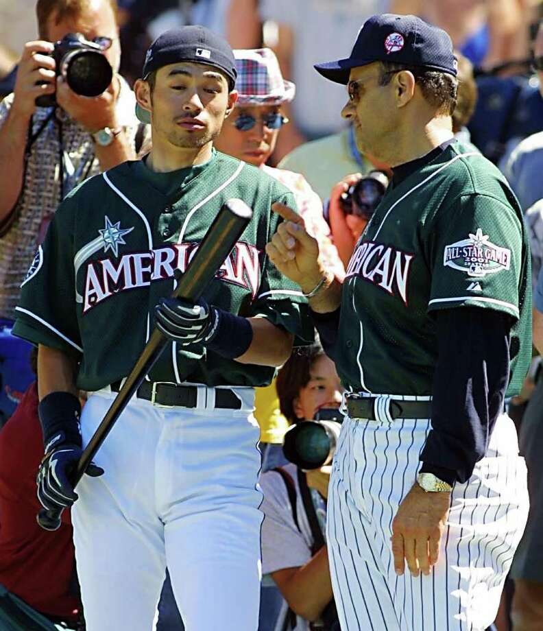 SEATTLE, UNITED STATES:  Seattle Mariners' Ichiro Suzuki of Japan (L) listens to American League Manager Joe Torre of the New York Yankees, during practice for the 2001 All-Star Game 09 July 2001, at Safeco Field in Seattle, Washington. Suzuki received 3.3 million votes to become the top vote getter for the 2001 game. The game is scheduled for 10 July.  AFP PHOTO/Dan LEVINE Photo: DAN LEVINE, AFP/Getty Images / AFP