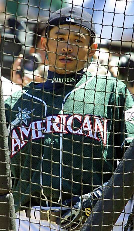 SEATTLE, UNITED STATES:  Seattle Mariners' All-Star centerfielder Ichiro Suzuki of Japan waits behind the batting cage during batting practice for the All-Star game 10 July, 2001 at Safeco Field in Seattle, Washington.     AFP PHOTO/Dan LEVINE Photo: DAN LEVINE, AFP/Getty Images / AFP
