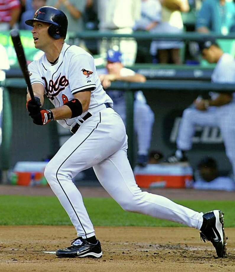 SEATTLE, UNITED STATES:  Cal Ripken Jr., of the Baltimore Orioles, watches his homerun clear the fence in the third inning of the baseball All-Star game 10 July, 2001, at Safeco Field in Seattle, Washington. Ripken is making in final appearance in the All-Star game. He is retiring after the 2001 season.  AFP PHOTO/Dan LEVINE Photo: DAN LEVINE, AFP/Getty Images / AFP