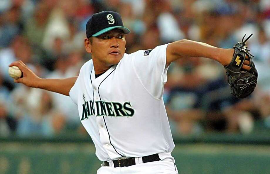 SEATTLE, UNITED STATES:  All-Star pitcher Japanese Kazuhiro Sasaki of the Seattle Mariners throws during the final inning of the baseball All-Star game 10 July, 2001 at Safeco Field in Seattle, Washington. Freddy Garcia was the winning pitcher as the American League won the game 4-1 and Sasaki got the save.    AFP PHOTO/Dan LEVINE Photo: DAN LEVINE, AFP/Getty Images / AFP