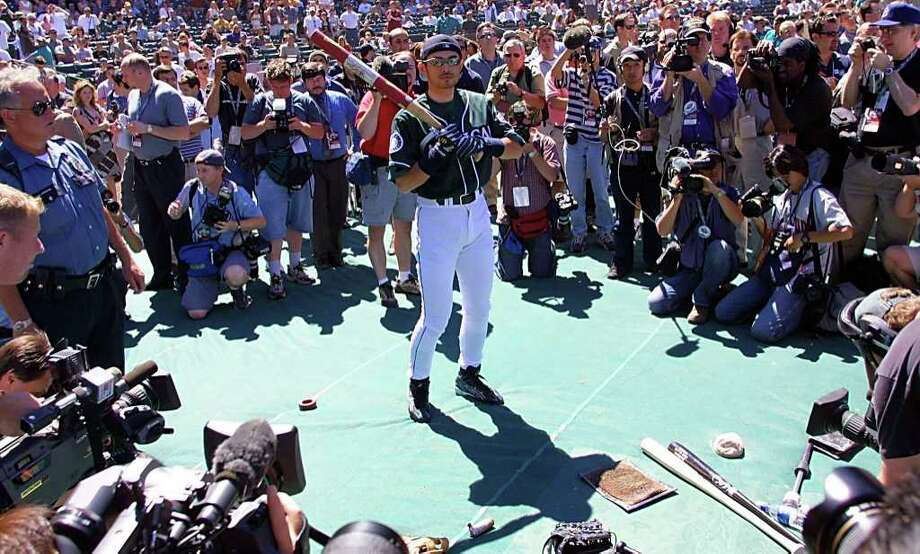 SEATTLE, WA - JULY 9:  Seattle Mariners' Ichiro Suzuki of Japan is surrounded by the media during a practice for the 2001 All-Star Game 09 July 2001, at Safeco Field in Seattle, Washington. Suzuki received 3.3 million votes to become the top vote getter for the 2001 game. Photo: JOHN MABANGLO, AFP/Getty Images / AFP
