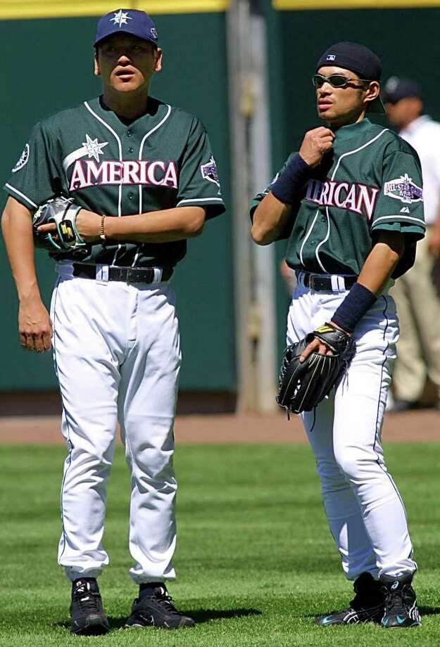 SEATTLE, WA - JULY 9:  Seattle Mariners' Ichiro Suzuki (R) of Japan talks to teammate, pitcher Kazuhiro Sasaki (L) during practice for the 2001 All-Star Game 09 July 2001 at the Safeco Field in Seattle, Washington. The All-Star game will be 10 July 2001. Photo: JOHN MABANGLO, AFP/Getty Images / AFP