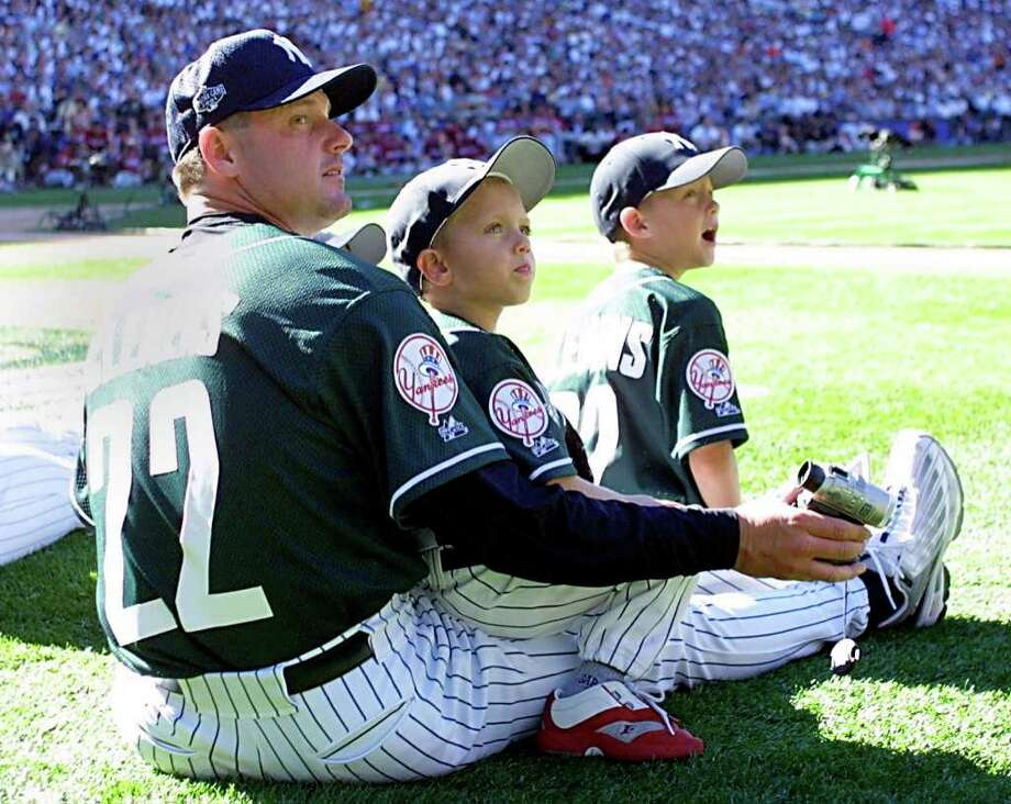 SEATTLE, WA - JULY 9:  American League All-Star starting pitcher Rodger Clemens (L) watches the 2001 Home Run Derby with his two sons at Safeco Field 09 July, 2001 in Seattle, Washington. The All-Star game will be held on 10 July, 2001. Photo: JOHN MABANGLO, AFP/Getty Images / AFP
