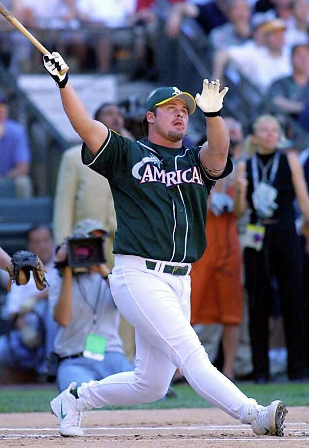 SEATTLE, WA - JULY 9:  American League All-Star Jason Giambi watches one of his fourteen home runs 09 July, 2001 in the 2001 Home Run Derby at Safeco Field in Seattle, Washington. The All-Star game is scheduled for 10 July, 2001. Photo: JOHN MABANGLO, AFP/Getty Images / AFP