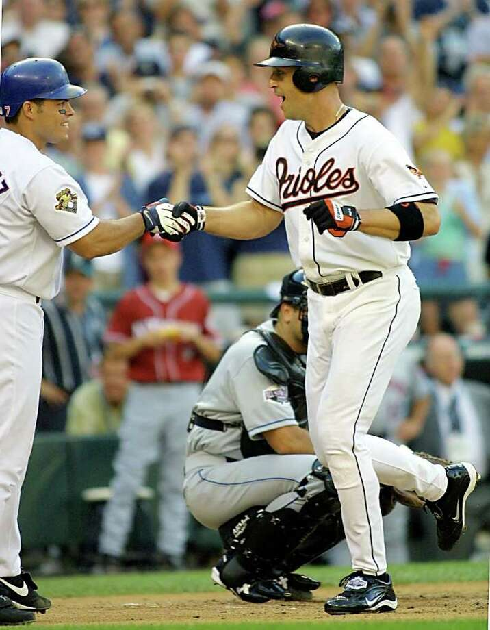 SEATTLE, WA - JULY 10:  Cal Ripken Jr., (R) of the Baltimore Orioles, shakes hands with catcher Ivan Rodriguez of the Texas Rangers after Ripken hit a first inning home run during the baseball All-Star game 10 July, 2001 at Safeco Field in Seattle, Washington. Ripken is making in final appearance in the All-Star. Photo: JOHN MABANGLO, AFP/Getty Images / AFP