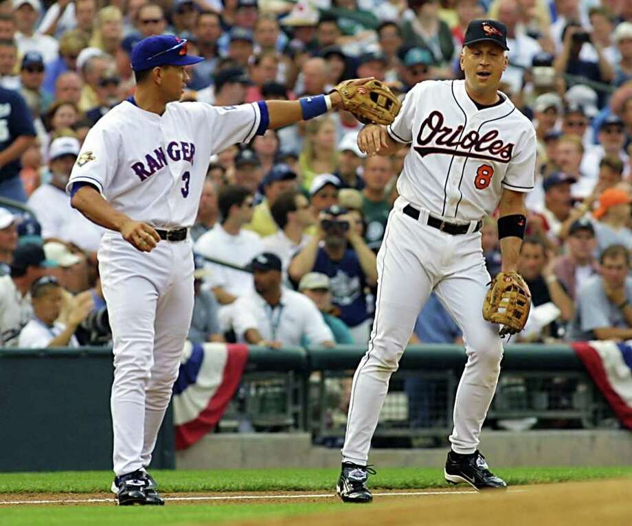 SEATTLE, WA - JULY 10:  Cal Ripken Jr., (R) of the Baltimore Orioles, asked to move to short stop position by American Leaguer Alex Rodriguez (L) during the first inning of the baseball All-Star game 10 July, 2001 at Safeco Field in Seattle, Washington. Ripken is making in final appearance in the All-Star game after nineteen season and played most of them as short stop. Photo: JOHN MABANGLO, AFP/Getty Images / AFP