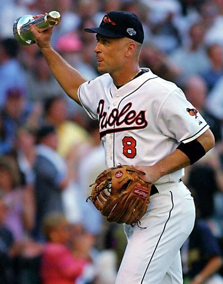 SEATTLE, WA - JULY 10:  Cal Ripken Jr. of the Baltimore Orioles walks off the field holding the Commissioner's Historic Achievement Award during the baseball All-Star game 10 July, 2001 at Safeco Field in Seattle, Washington. Ripken is making his final All-Star game appearance after playing in 19 All-Star games, mostly at shortstop. Photo: JOHN MABANGLO, AFP/Getty Images / AFP