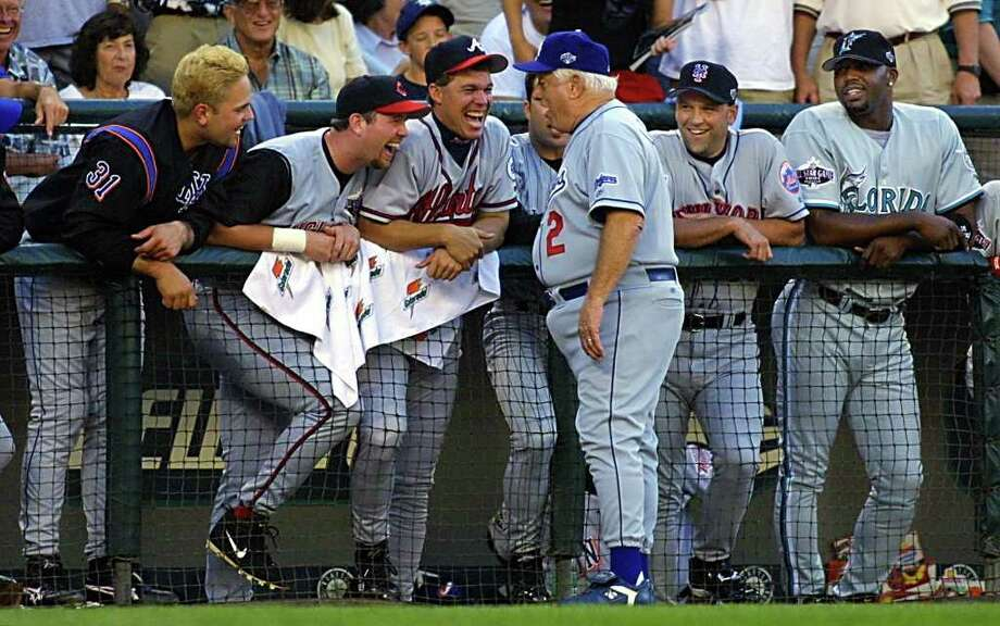 SEATTLE, WA - JULY 10:  Former Los Angeles Dodgers manager Tommy Lasorda (C front) shares a laugh with the National League bench after Lasorda was hit with a bat while coaching third base during the baseball All-Star game 10 July, 2001 at Safeco Field in Seattle, Washington. Photo: JOHN MABANGLO, AFP/Getty Images / AFP