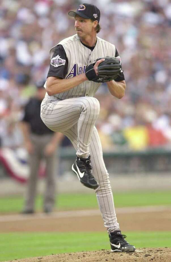10 Jul 2001:  Randy Johnson of the Arizona Diamondbacks pitches for the National League during the 2001 Major League Baseball All-Star game at Safeco Field in Seattle, Washington, won by the American League 4-1. DIGITAL IMAGE Mandatory  Credit: Otto Gruele/Allsport Photo: Otto Greule Jr, Getty Images / Getty Images North America