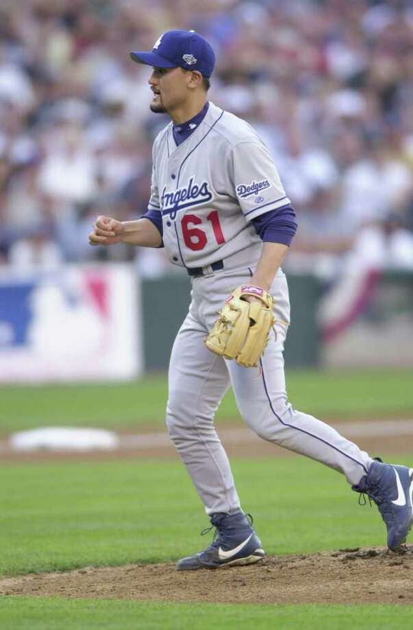 10 Jul 2001:  Chan Ho Park of the Los Angeles Dodgers reacts on the mound during the 2001 Major League Baseball All-Star game at Safeco Field in Seattle, Washington, won by the American League 4-1. DIGITAL IMAGE Mandatory  Credit: Otto Gruele/Allsport Photo: Otto Greule Jr, Getty Images / Getty Images North America