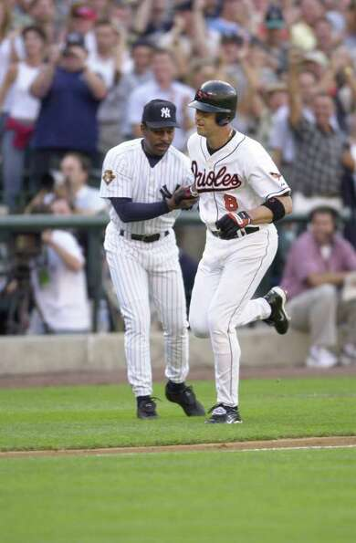 10 Jul 2001:  Cal Ripken Jr. of the Baltimore Orioles is congratulated by third base coach Willie Ra