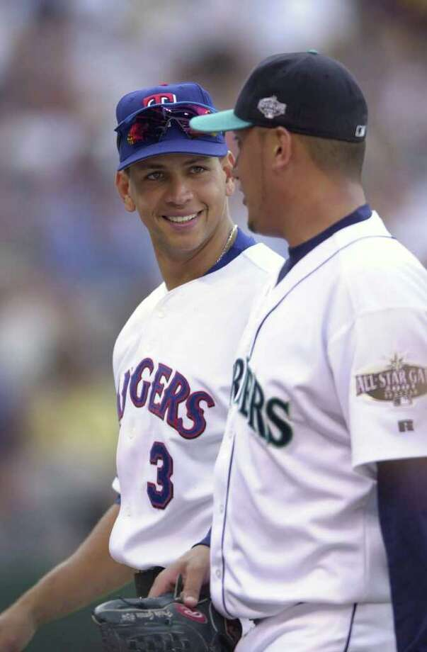 10 Jul 2001:  Alex Rodriguez of the Texas Rangers (l) talks with  Freddy Garcia of the Seattle Mariners during the 2001 Major League Baseball All-Star game at Safeco Field in Seattle, Washington, won by the American League 4-1. DIGITAL IMAGE Mandatory  Credit: Otto Gruele/Allsport Photo: Otto Greule Jr, Getty Images / Getty Images North America