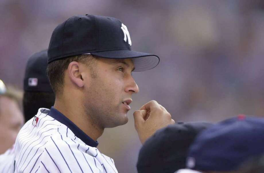 10 Jul 2001:  Derek Jeter of the New York Yankees watches the action from the dugout during the 2001 Major League Baseball All-Star game at Safeco Field in Seattle, Washington, won by the American League 4-1. DIGITAL IMAGE Mandatory  Credit: Otto Gruele/Allsport Photo: Otto Greule Jr, Getty Images / Getty Images North America