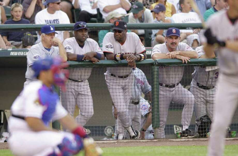 10 Jul 2001:  Four non-playing members of the National League contingent (from left--Los Angeles Dodgers former manager Tommy Lasorda, San Diego Padres rightfielder Tony Gwynn, San Francisco Giants manager Dusty Baker, and San Diego Padres manager Bruce Bochy) watch the action during the 2001 Major League Baseball All-Star game at Safeco Field in Seattle, Washington, won by the American League 4-1. DIGITAL IMAGE Mandatory  Credit: Otto Gruele/Allsport Photo: Otto Greule Jr, Getty Images / Getty Images North America
