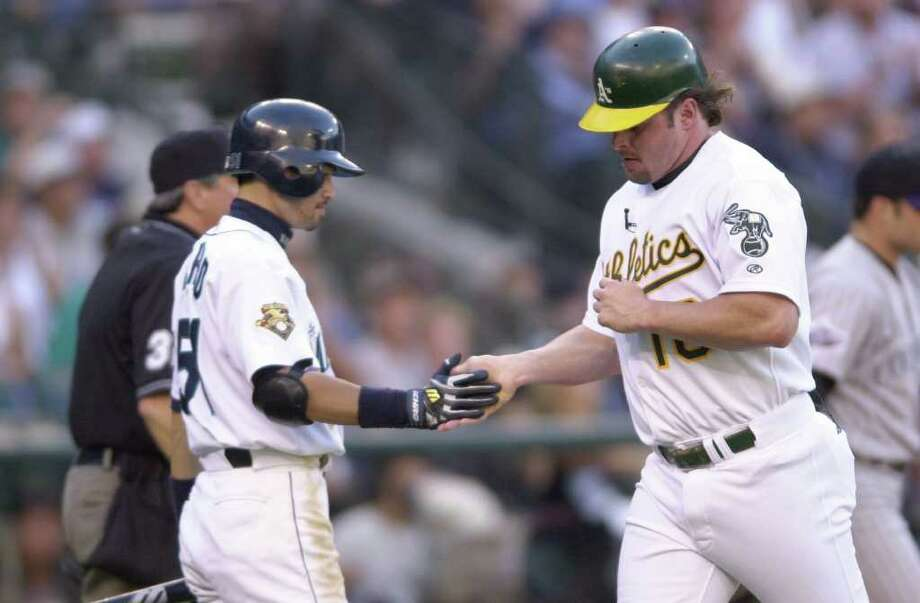 10 Jul 2001:  Jason Giambi of the Oakland Athletics (r) is congratulated by Ichiro Suzuki of the Seattle Mariners after Giambi scored a run during the 2001 Major League Baseball All-Star game at Safeco Field in Seattle, Washington, won by the American League 4-1. DIGITAL IMAGE Mandatory  Credit: Otto Gruele/Allsport Photo: Otto Greule Jr, Getty Images / Getty Images North America