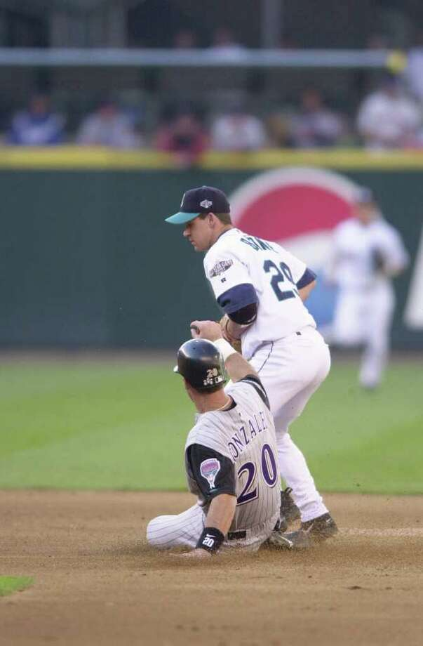 10 Jul 2001:  Luis Gonzalez #20 of the Arizona Diamondbacks slides into second base as Bret Boone of the Seattle Mariners covers during the 2001 Major League Baseball All-Star game at Safeco Field in Seattle, Washington, won by the American League 4-1. DIGITAL IMAGE Mandatory  Credit: Otto Gruele/Allsport Photo: Otto Greule Jr, Getty Images / Getty Images North America