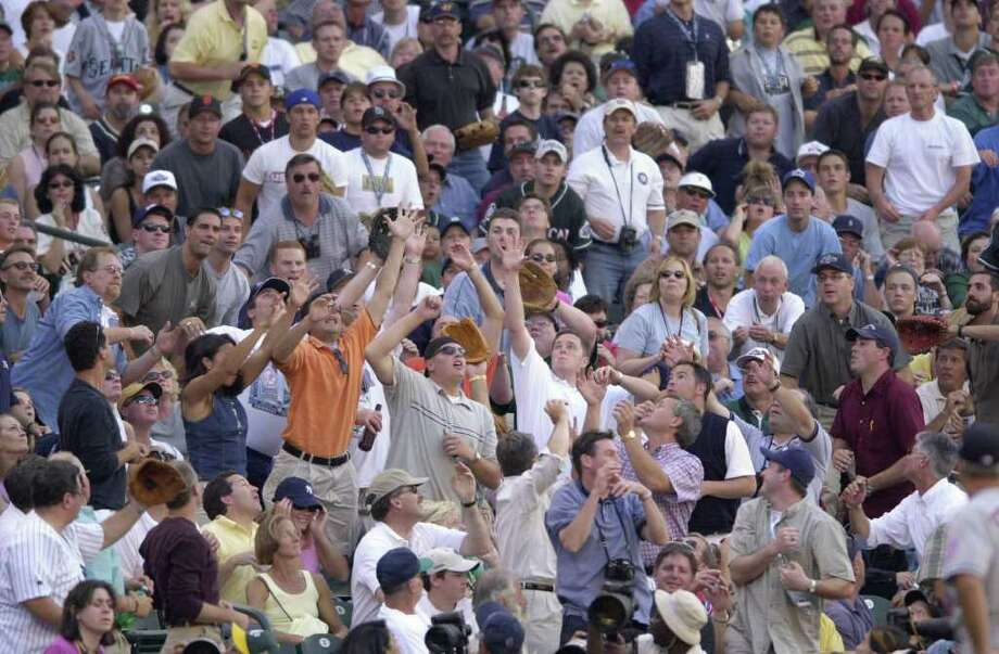 10 Jul 2001:   Fans reach for a foul ball in the stands during the 2001 Major League Baseball All-Star game at Safeco Field in Seattle, Washington, won by the American League 4-1. DIGITAL IMAGE Mandatory  Credit: Otto Gruele/Allsport Photo: Otto Greule Jr, Getty Images / Getty Images North America