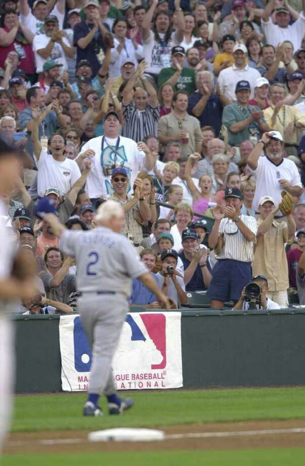 10 Jul 2001:  The crowd cheers former Los Angeles Dodgers manager Tommy Lasorda after Lasorda was struck by a flying bat while coaching third base during the 2001 Major League Baseball All-Star game at Safeco Field in Seattle, Washington, won by the American League 4-1. DIGITAL IMAGE Mandatory  Credit: Otto Gruele/Allsport Photo: Otto Greule Jr, Getty Images / Getty Images North America