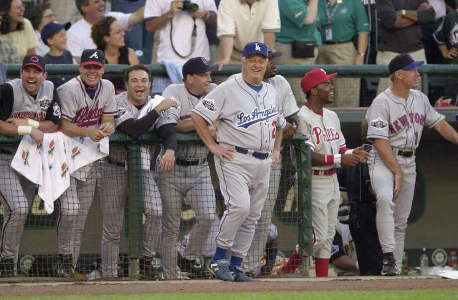 10 Jul 2001:  Former Los Angeles Dodgers manager Tommy Lasorda jokes with National League players (left to right,  Sean Casey, Cincinnati Reds, Chipper Jones, Atlanta Braves, Rick Reed, New York Mets, Cliff Floyd, Florida Marlins, and Jimmy Rollins, Philadelphia Phillies) after being struck by a flying bat while coaching third base during the 2001 Major League Baseball All-Star game at Safeco Field in Seattle, Washington, won by the American League 4-1. DIGITAL IMAGE Mandatory  Credit: Otto Gruele/Allsport Photo: Otto Greule Jr, Getty Images / Getty Images North America