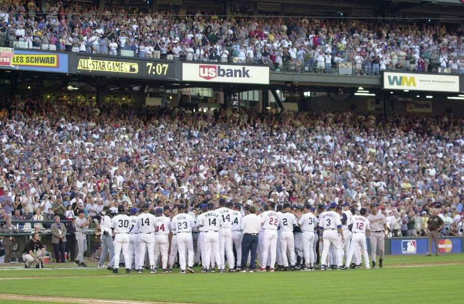 10 Jul 2001:  Members of both teams gather for a ceremony honoring retiring players Cal Ripken Jr. of the Baltimore Orioles and Tony Gwynn of the San Diego Padres during the 2001 Major League Baseball All-Star game at Safeco Field in Seattle, Washington, won by the American League 4-1. DIGITAL IMAGE Mandatory  Credit: Otto Gruele/Allsport Photo: Otto Greule Jr, Getty Images / Getty Images North America